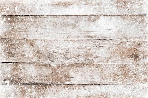 크리스마스 배경 눈이 오래 된 흰색 나무 질감입니다. 상위 뷰, 테두리 프레임 디자인. 빈티지하고 소박한 스타일