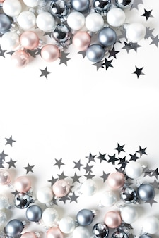 Christmas background of pastel colorful baubles on white