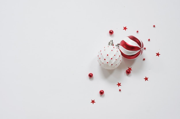 Christmas background - red decorations on white table. christmas, winter, new year concept. flat lay, top view