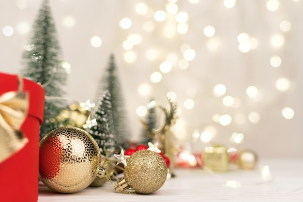 Christmas background , red gift box with a golden bow on the background of christmas bokeh. copy space