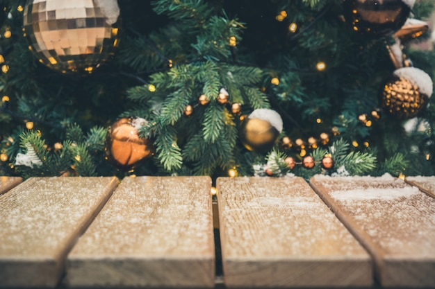 Christmas background of tabletop and blurred gold garland,