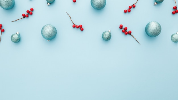 Christmas background with blue balls and mistletoe