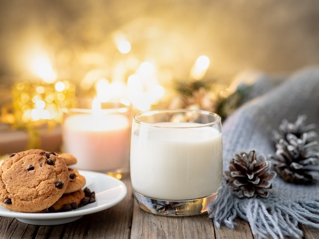 Christmas background with chocolate chip cookies, glass of milk.