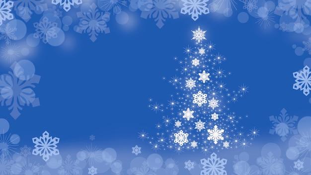 クリスマスツリーと青の端の周りに雪片とクリスマスの背景