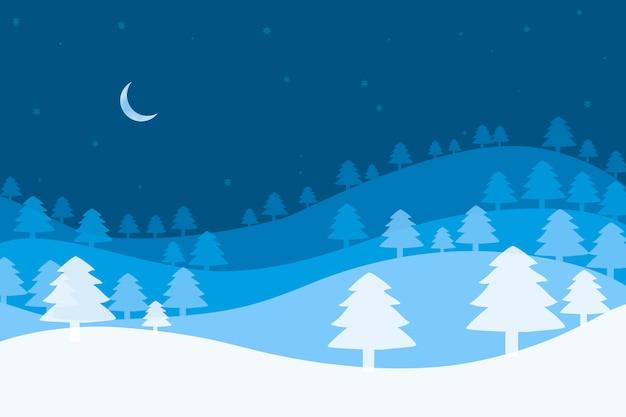 青い背景にクリスマスツリーと三日月とクリスマスの背景。