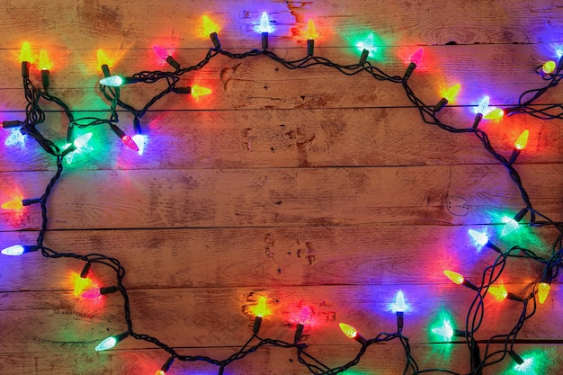 Christmas background with colorful lights and free text space.