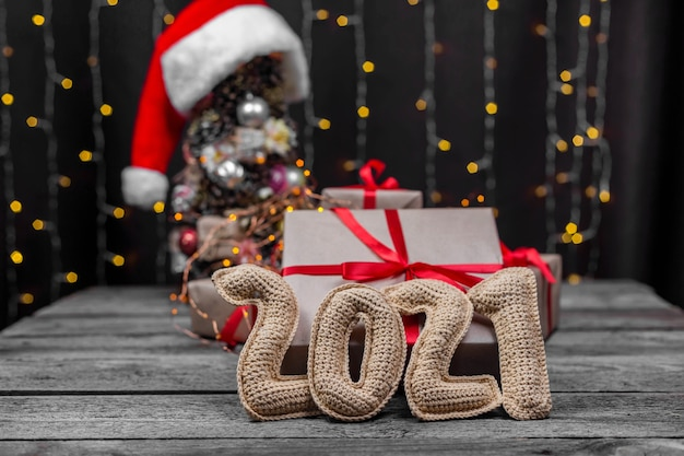 Christmas background with crocheted numbers 2021