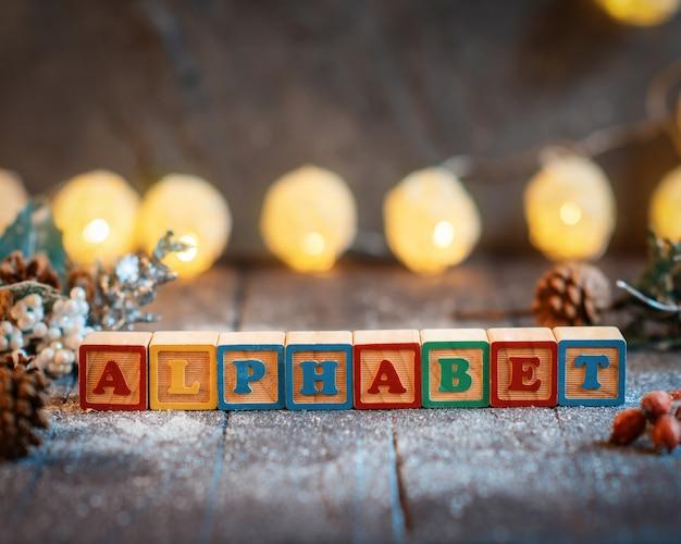 装飾と碑文「アルファベット」とクリスマスの背景