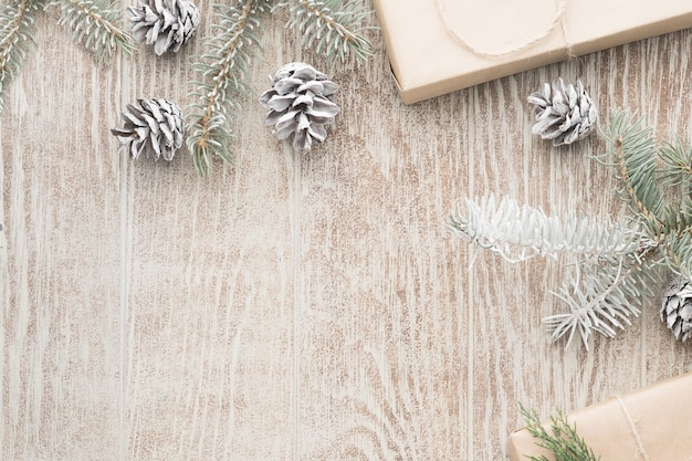 Christmas background with decorations and gift boxes on wooden table. flat lay, top view. christmas composition