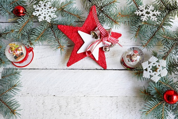Christmas background with decorative star, fir branches and new year decor, copy space