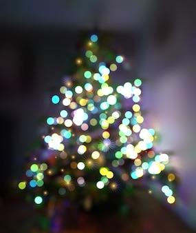 焦点がぼけた木とライトとクリスマスの背景
