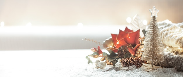 Christmas background with details of festive decor on a blurred background copy space.