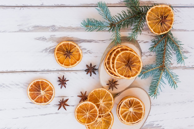 Christmas background with fir branches, anise stars and oranges with copy space