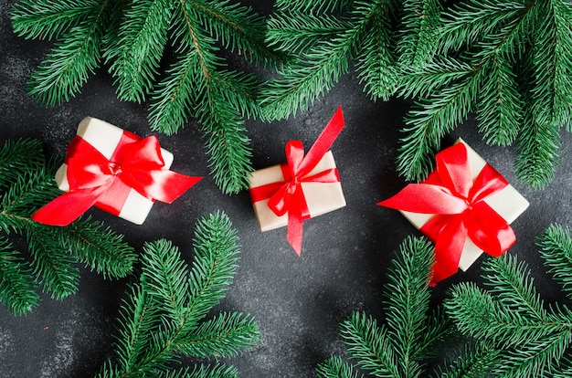 Christmas background with fir tree and christmas gift boxes.