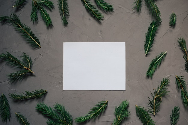Christmas background with fir tree and decor. copy space, gray plastered background