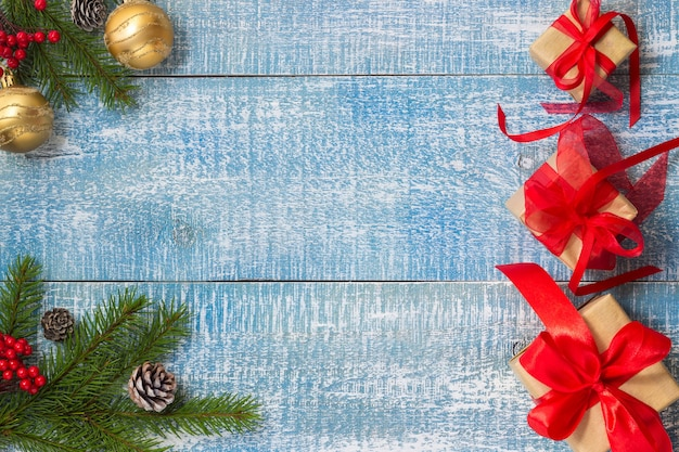 Christmas background with fir tree, gifts and decoration.