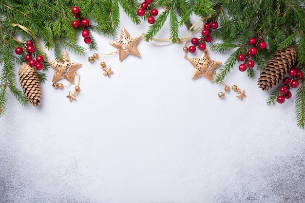 Christmas background with fir tree, red and gold gifts