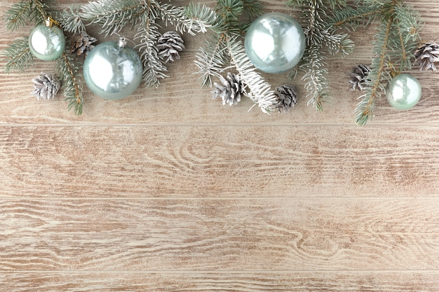 Christmas background with fir tree, xmas balls and decor. top view, flat lay, copy space