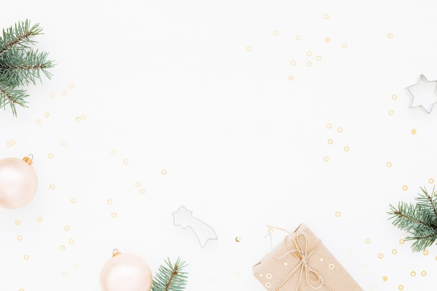 Christmas background with gift box, green fir, decorations on white