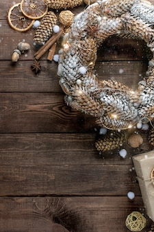 Christmas background with holiday decor on a wooden background