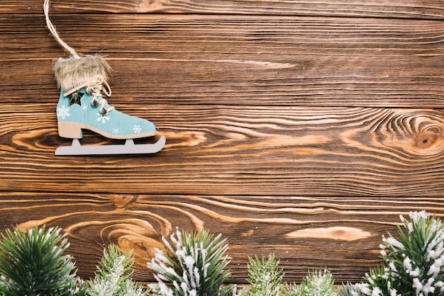 Christmas background with ice skate on wooden surface