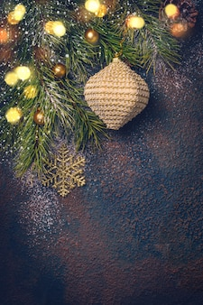 Christmas background with natural fir branches and toys