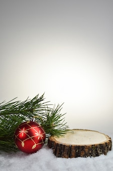 Christmas background with natural wood podium for product presentation
