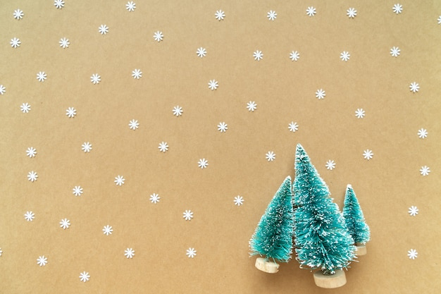 Christmas background with paper snow flake and decoration, tree on paper