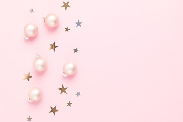 Christmas background with pink xmas ornaments
