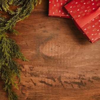 Christmas background with presents and fir branches