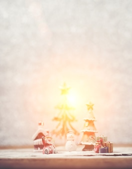 Christmas background with santa claus and a snowman