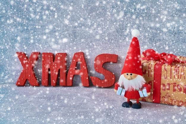 Christmas background with santa claus and gifts. copyspace, snow texture