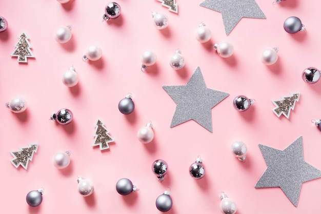 Christmas background with silver balls, stars on pink