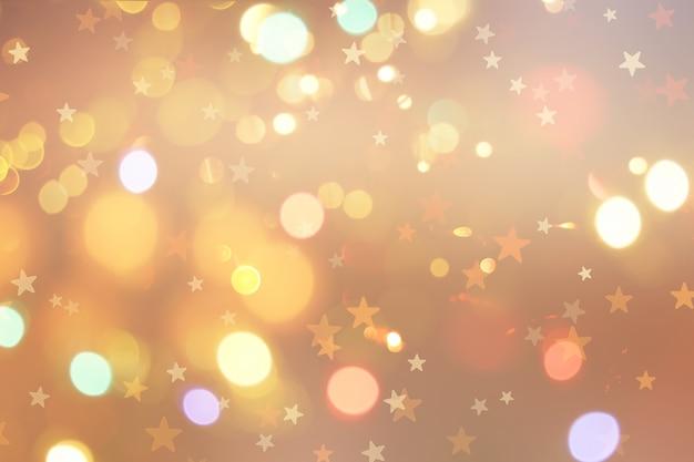 Новогодний фон со звездами и огнями боке