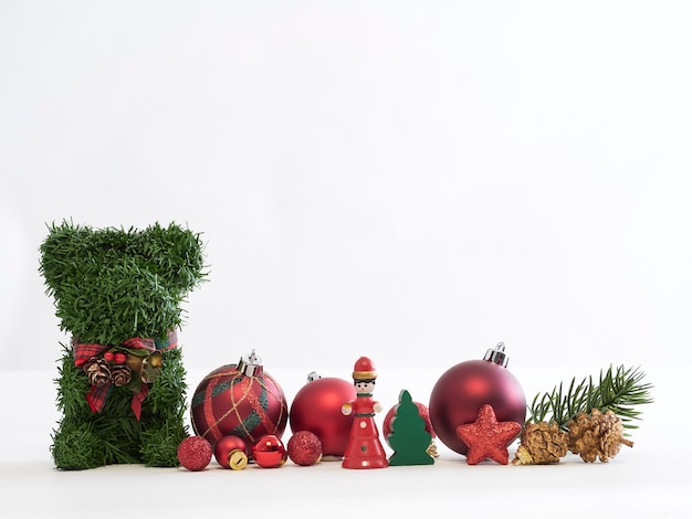 Christmas background with teddy bear and decorations on white background