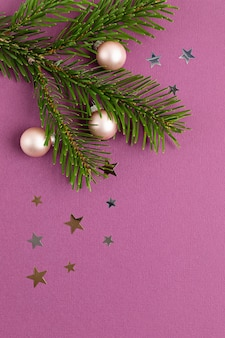 Christmas background with xmas tree brances and ornaments