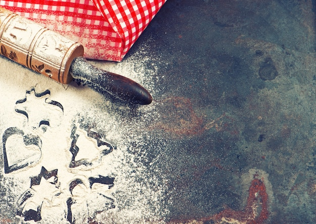Christmas backing food concept. holidays background. kitschen toos and utensils. vintage style toned picture