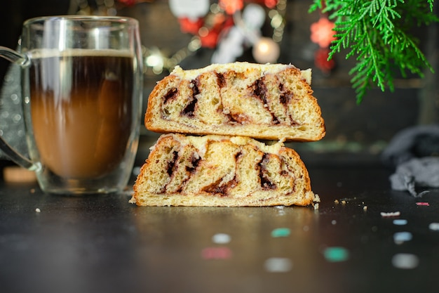 Christmas baked cake on black table
