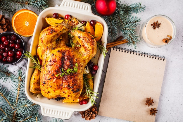 Christmas baked chicken with cranberries, orange, spices and herbs. christmas food concept.