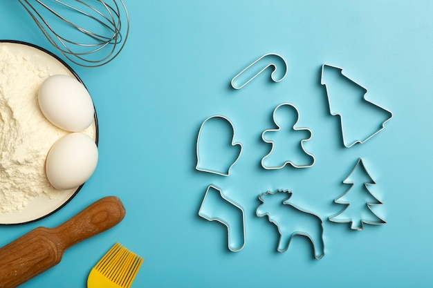 Christmas baking background christmas cookie cutters molds on the kitchen baking table festive food ...