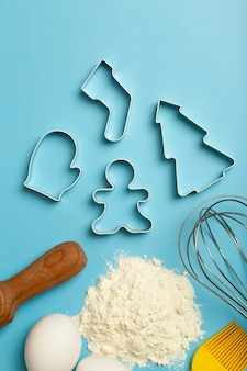 Christmas baking background christmas cookie cutters molds on the kitchen baking table