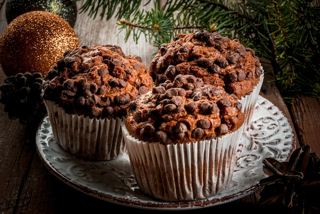 Christmas baking, three chocolate muffins on a plate