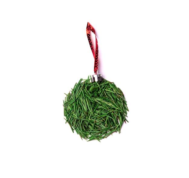 Christmas ball on the christmas tree on red line