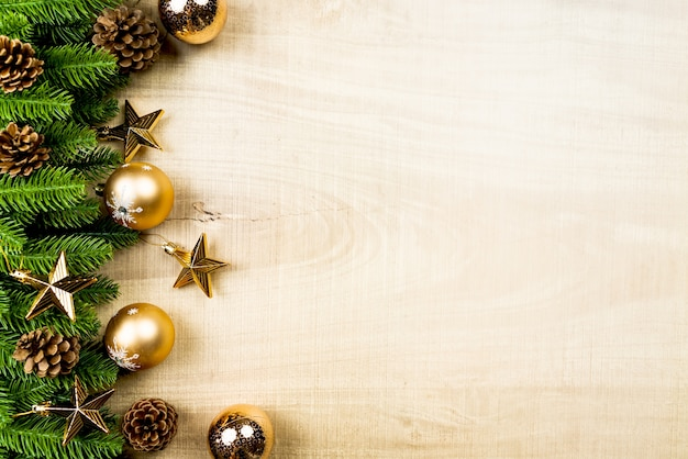 Christmas ball and pine tree with xmas decoration on wooden background