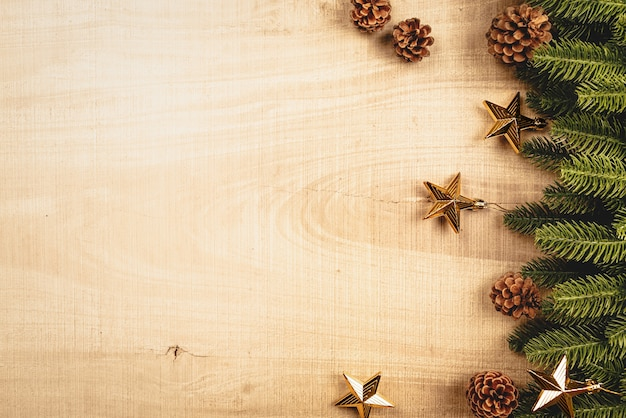 Christmas ball and pine tree with xmas decoration on wooden