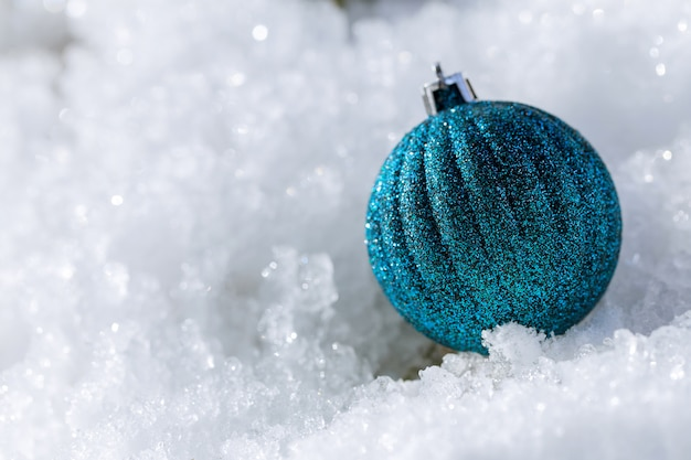 Christmas ball in the snow