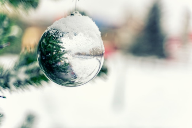 Christmas ball on spruce branches covered with snow. new year and christmas concept