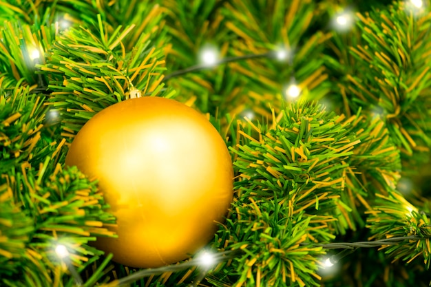 Christmas ball on tree. closeup on christmas tree decoration over festive background