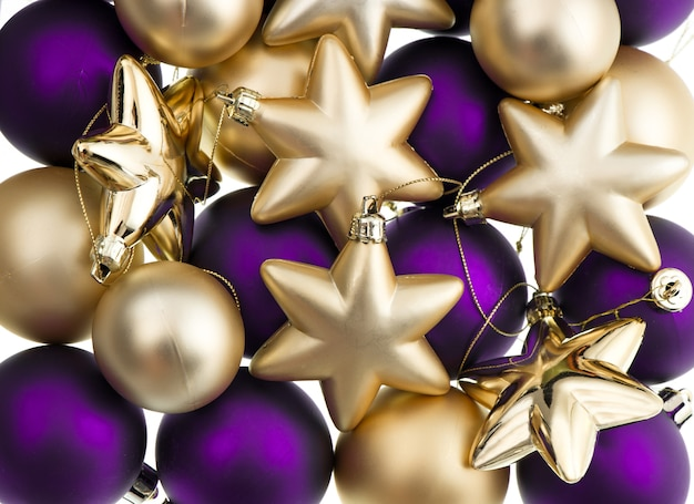 Christmas balls decoration. closeup of lila and golden baubles