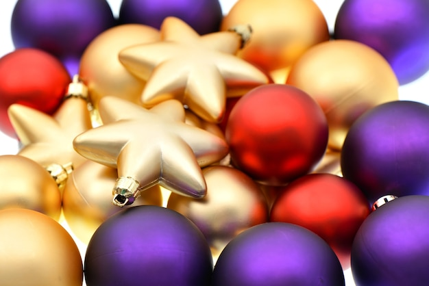 Christmas balls decoration. closeup of lila, red and golden baubles